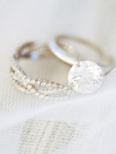 i love the simple ring with the fancy wedding band!