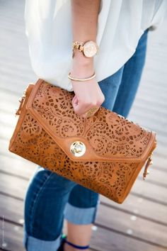 Pretty tan clutch with detailed cutouts.