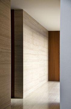 Vincent Van Duysen. Travertine marble walls.