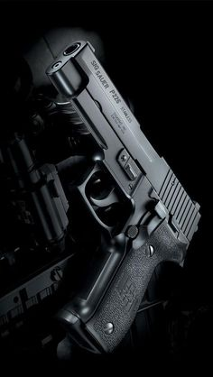 """Smith's gun, a Sig Sauer P226. """"Lily slowly reached her hand out. 'Oooooh,' she cooed as she rubbed her finger tips across the barrel. 'Shiny.'"""""""