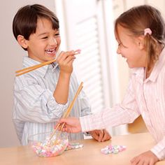 Using only chopsticks, kids get a certain amount of time to try and get the most candy hearts.