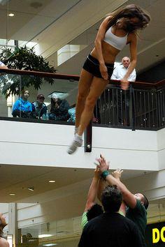 Cheerleaders will stunt anywhere.