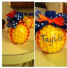 Lemon drops in a round bottle add laces and a bow. Change to a white candy for baseballs. Cute gift for team.