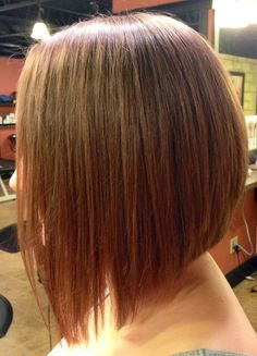 Long Inverted bob with a dramatic angle. Minimal stacking in the back.