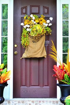Fall front door arrangement in burlap sack - two homes FULL of fall inspiration!