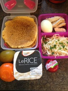 Chicken, egg and noodles, mandarin, gluten free pancakes, cheese and kiwi fruit, kids school lunch.