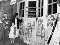 A Japanese family returning home from a relocation center camp in Hunt, Idaho, found their home and garage vandalized with anti-Japanese graffiti and broken windows in Seattle, Washington, on May 10, 1945. (AP Photo)