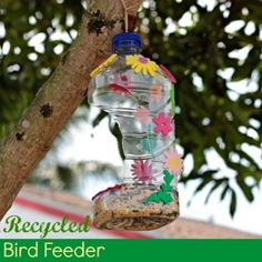 Totally fun idea for Earth Day: Turn a recycled bottle into a pretty bird feeder.