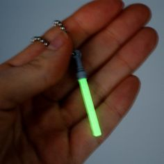 Glow-in-the-Dark lightsaber necklace! Ah! That's awesome!...OOOO I need this!