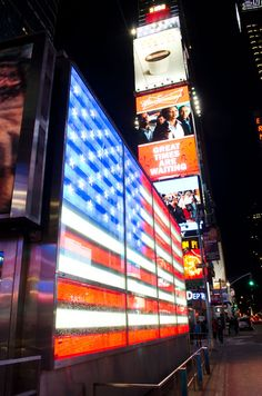 I find corporate irony in the electronic American flag surrounded by the commercialism of Times Square multi-media advertising