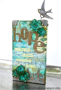Stamptramp: Hope is a Thing With Feathers.  Altered wood block made with sticky back canvas