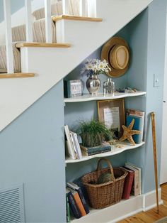 Shelving under stairs.