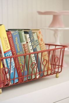 Old cookbooks in a dish rack - cute! kitchens, old dishes, country cottages, vintage dishes, dish rack, antique dishes, display, cookbooks, wire baskets