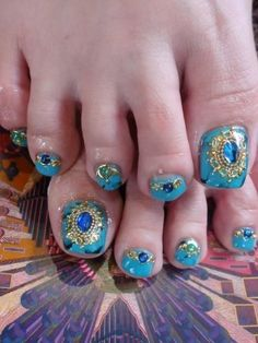 Pretty pedicure: a beautiful turquoise polish with jewel design. LOVE THIS!!