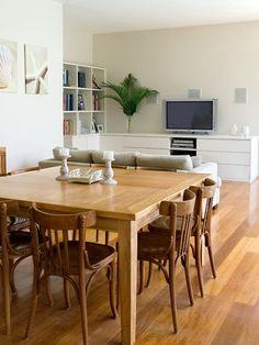 Wooden square table for eat-in kitchen.