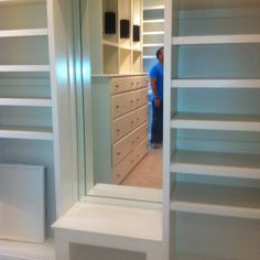 Seating and full length mirror in the master closet