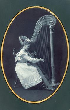 Girl Playing Large Harp