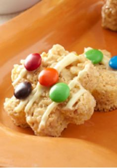 Peanut Butter-Polka Dot RICE KRISPIES® TREATS™ -- RICE KRISPIES® TREATS™ are made even better with creamy peanut butter, melted white chocolate and colorful candy in this delicious dessert recipe.