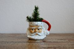 I still have my vintage 1951 Santa mug like this one from when I was one year old.