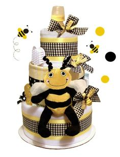 Bumblebee 3 tier diaper cake includes:  35 Brand name diapers 1 baby receiving blanket 2 Cotton diaper burp cloth 1 Bumblebee Plush Stuffed Animal 2-3 Johnson & Johnson baby care items  (trial size) 1 - 8oz feeding bottle (BPA Free) 1-2 teether links Deocrative Ribbons Measures approximately 16 inches high x 10 inches in diameter Arrives beautifully wrappedin cellophane.  #timelesstreaure