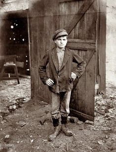 """August 1908. """"A Glass Works Boy waiting for the Night Shift. Indiana Glass Works."""" Photograph by Lewis Wickes Hine"""