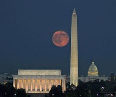A full moon behind the National Mall in Washington, D.C.