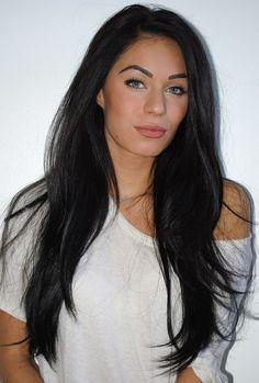 Long black styled hair. Makeup