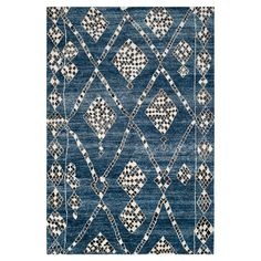 RUG IN BLUE Anchor your living room seating group or master suite decor with this eye-catching hand-knotted rug, showcasing a geometric trellis motif in blue and black.