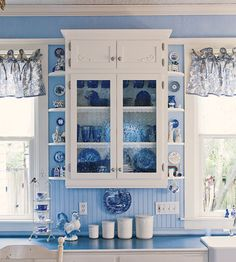 Seeded glass in the cupboards and old-fashioned beadboard in a Victorian farmhouse.