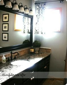 like the vanity...would want two sinks.  Like the framed mirror and lighting.  Like the colors