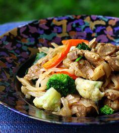 Stir fried noodles with brandied pork and vegetables