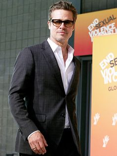 Ever the supportive partner, Brad Pitt heads to the Global Summit to End Sexual Violence in Conflict, co-chaired by fiancée Angelina Jolie, Wednesday at London's Excel Centre.