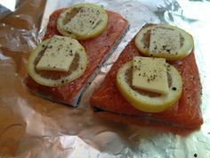 Dinner Tonight! Mmmmmmm.   Simple Salmon:  Place 4-6 oz salmon fillets in their own foil pouch.  Top with slices of lemon and large chunks of real butter.  Crack salt and pepper on top, fold up the foil packet, place on baking sheet and bake at 350 for 20-25 minutes.  Serve with spinach, carrots and a baked potato.