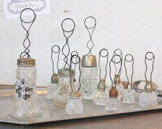 Photo holders with vintage salt shakers, etc.  Precious.
