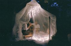 twinkly lights + mosquito netting, oh please future husband note this.