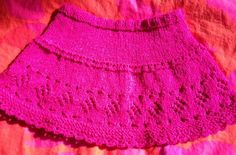 Pink sparkling short skirt for girls age 2-4.  Knitted in rounds and has a lace diamond border.  Pattern is free.