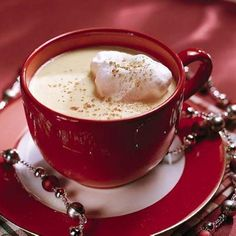 Egg Nog | Welcome holiday guests with a cup of rich homemade egg nog laced with both brandy and rum and garnished with whipped cream and nutmeg. | SouthernLiving.com