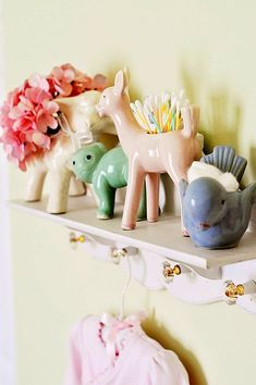 vintage girls nursery - okay, maybe not for a girls nursery, but I love the using vintage planters as little catch all...maybe for my bathroom, one day...