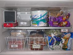 Labeled wire containers can organize even small freezers above the fridge {featured on Home Storage Solutions 101}
