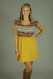 Your Fall wardrobe is not complete without this dress!! The gorgeous colors up top are complimented by the mustard color on the bottom. The forgiving fit is great thanks to the elastic waist. This one would look great with just about any boot:) P.S...It's FULLY lined!!!  Fits true to size. Kalan is wearing the small.