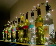 wine bottle lights. these are perfect for lining the top of the bar, instead of boring empty bottles
