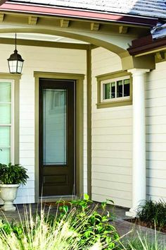 Not just for siding, fiber cement trim boards allow you to create a variety of non-structural architectural elements, such as column wraps, friezes, fascia, gables, and other accent areas. Using a contrasting color on trim and embellishments adds drama and dimension. | Photo: James Hardie