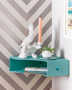 Turn a wood magazine holder into a corner wall shelf.