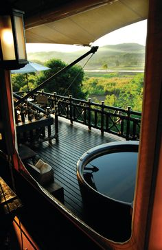 Don't be surprised if an elephant strolls by as you soak in your private deck tub at @Four Seasons Tented Camp Golden Triangle