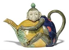 A MINTON MAJOLICA MONKEY TEAPOT AND COVER