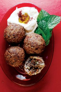 Kibbeh (Beef and Bulgur Wheat Meatballs) Recipe -Middle Eastern kibbeh is a finely ground paste of bulgur, onions, and lamb or beef, which is formed into patties or balls, filled with coarsely ground, sweetly spiced meat, onions, and pine nuts, and deep-fried. - Saveur.com food recip, kibbeh beef, bulgur wheat, lambs, wheat meatbal, meatball recipes, onion, middl eastern, middle east