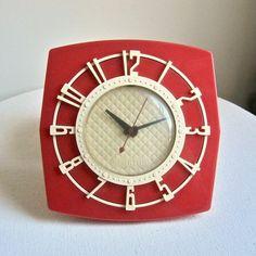 Mid Century Red Plastic Kitchen Clock, circa 1960