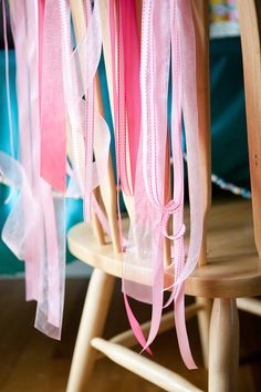 Add ribbons to the back of the birthday girl's chair