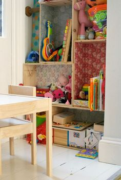 Upcycled crates lined with colorful wallpaper make great toy storage.
