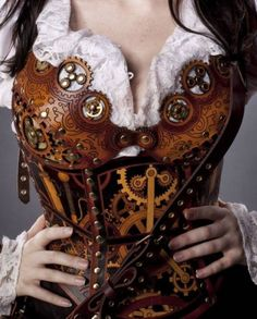 Steamer style tooled leather corset. Multi-dyed, and maybe some overlaid pieces. Bravo!